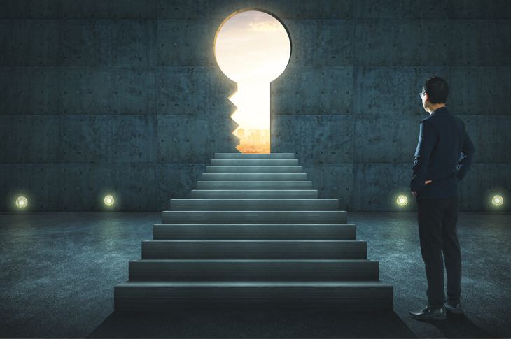 Sillhouette of a man staring at a key shaped portal - Content marketing ideas to promote your brand online - Scatter