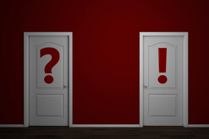 Two doors, one with question mark and other with exclamation mark painted on them - Outsourcing Content, Content Marketing Scatter