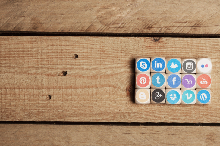 social media marketing - social media logos printed on wooden blocks, placed together