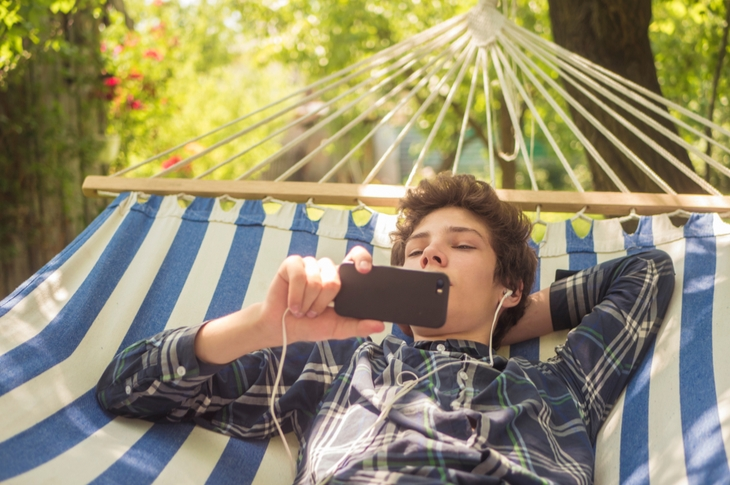 video marketing - a boy watching a video on his phone