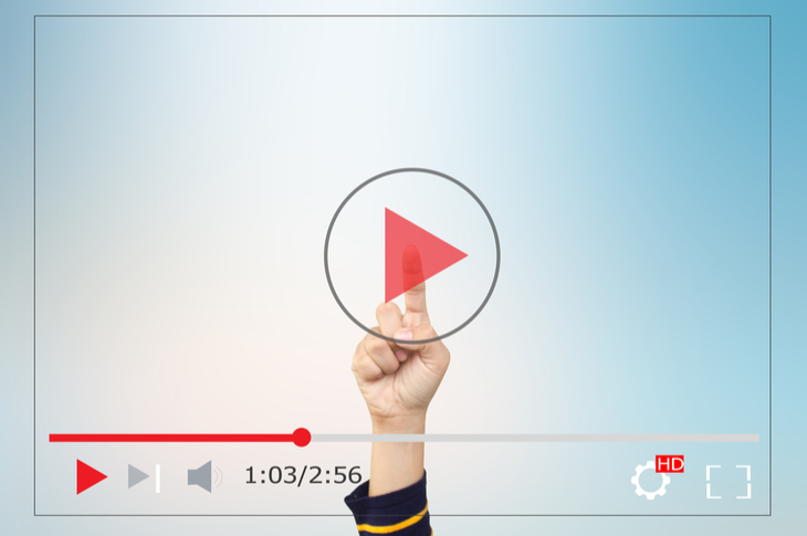 videos - a hand tapping the play button of a video