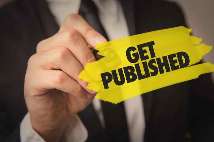 """publishers need branded content - a businessman writing """"GET PUBLISHED"""""""