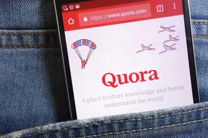 phone tucked into pocket indicating content marketing through quora