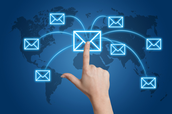 email marketing of branded content indicated by a hand sending out emails