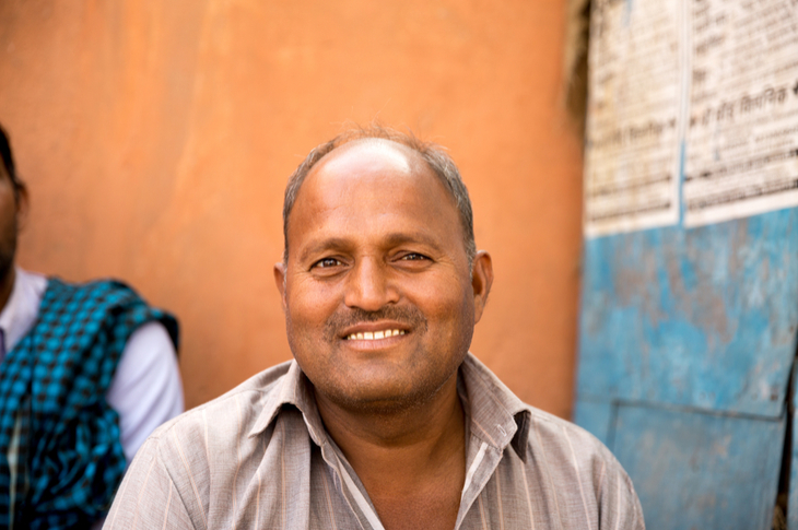 Indian man from one of the new cities smiling into the camera lens