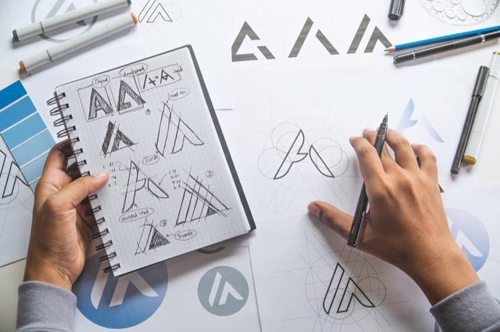 hands designing brand logo