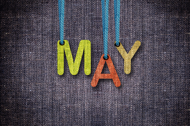 May letters hanging strings with blue sackcloth background - Content Marketing Ideas