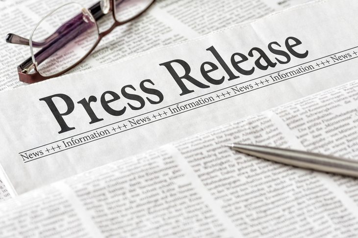 Press Releases Concept - A newspaper with the headline Press Release - Image