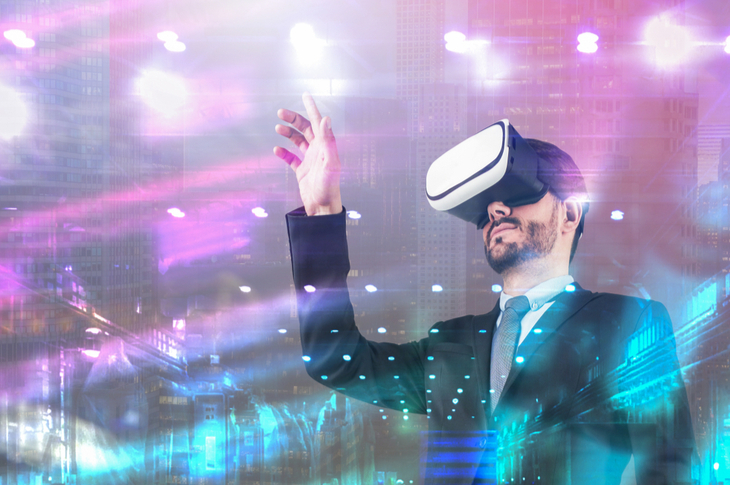 Serious young man in suit using virtual reality headset over night cityscape background - Scatter