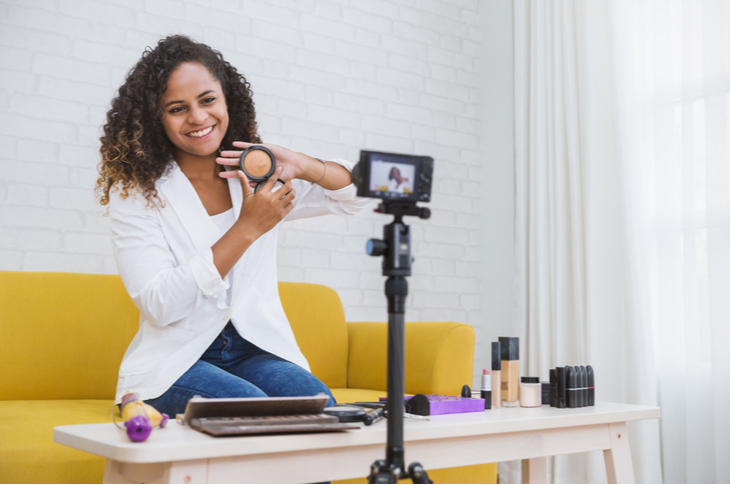 Portrait of black blogger woman review giveaway make up gift to fan following channel while recording video makeup cosmetic at home online influencer vlogger girl social media live steaming - Influencer Marketing engagement concept